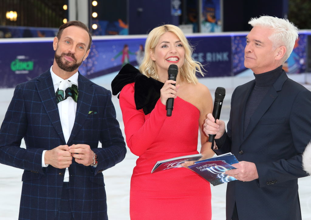 Jason Gardiner, Holly Willoughby and Phillip Schofield stand on the ice rink during Dancing on Ice filming