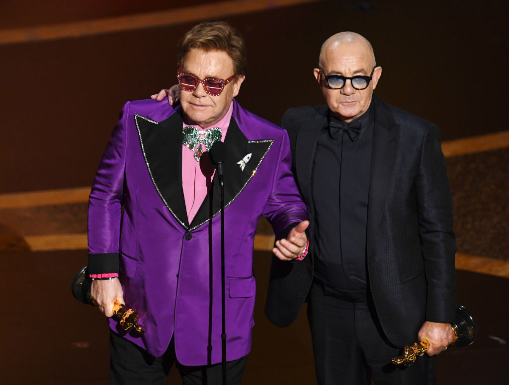 Elton John and Bernie Taupin accept the Original Song award for 'I'm Gonna Love Me Again'