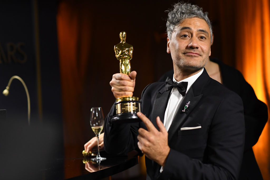 Taika Waititi poses with his Oscar for Adapted Screenplay