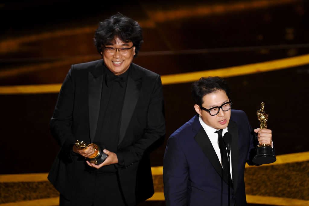 Bong Joon-ho and Han Jin-won accept the award for Original Screenplay