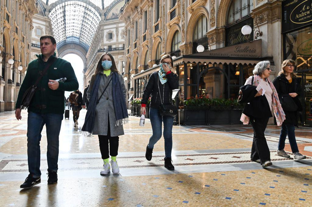 People wearing a protective facemasks at the Gallery Vittorio Emanuele II, in central Milan, amid the Coronavirus outbreak