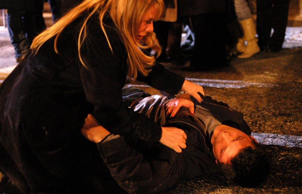 Actress Letitia Dean, who plays Sharon, and Nigel Harman, who played Dennis Rickman, during Dennis' death scene in 2005