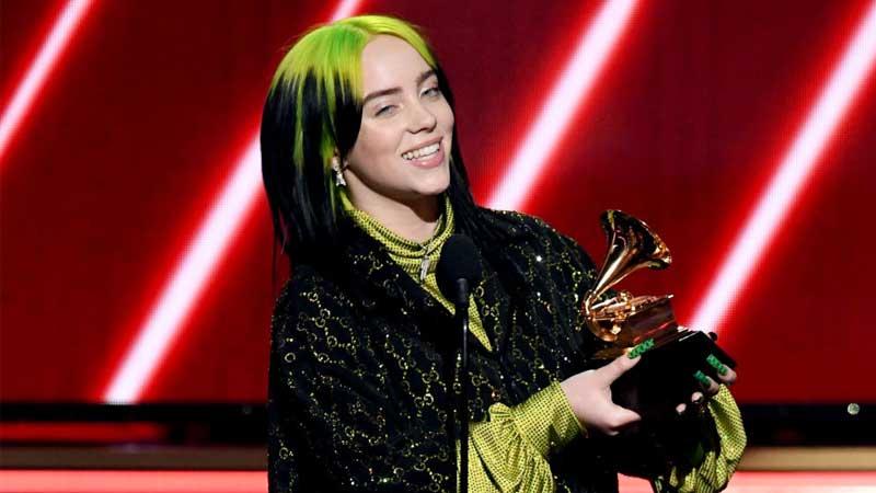 Billie Eilish holding her Grammy