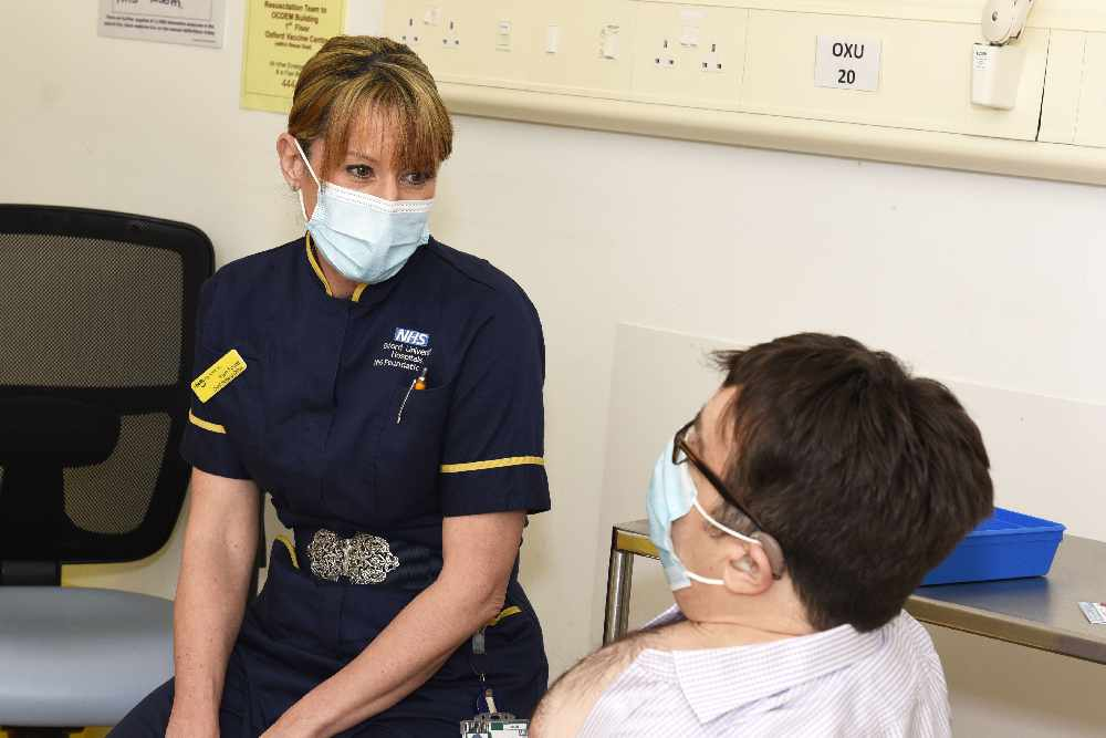 Sam Foster, Chief Nursing Officer, and Nicholas Woodthorpe, the first patient at the OUH Vaccination Centre