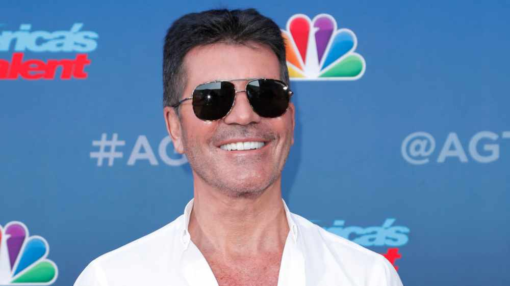 Simon Cowell recovering following six hour surgery after breaking his back